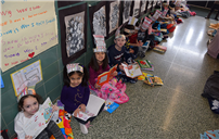 Lining the Hallway with Readers photo