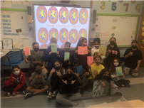 Fifth graders from Mrs. Macaluso's class from Barnum Woods with their cards. thumbnail183613
